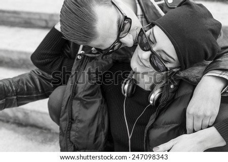 Couple with style cuddling and kissing. - stock photo