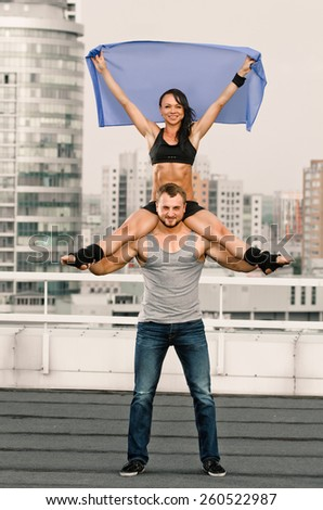 couple woman man exercising workout fitness aerobics on the house-top - stock photo