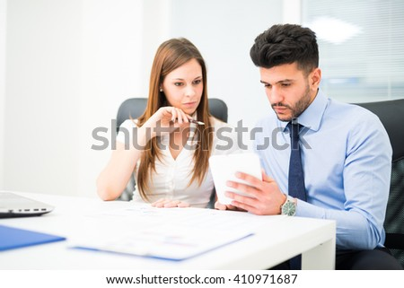 Couple working in their office - stock photo