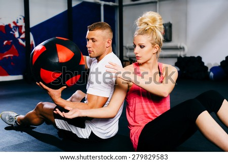 Couple workout with training ball at gym - stock photo