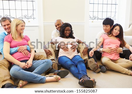 Couples Attending Ante Natal Class Together - stock photo