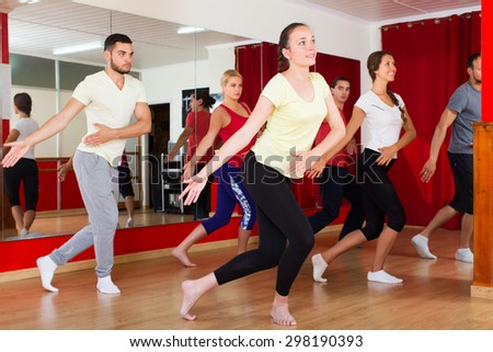Couples dancing contemp in studio smiling and having fun - stock photo