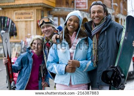 Couples on ski vacation - stock photo