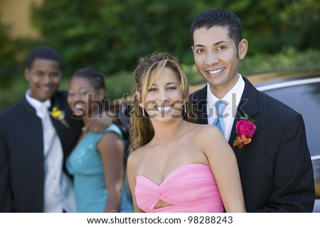 Couples on Their Way to Prom - stock photo