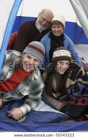 Couples relaxing in tent, (portrait) - stock photo