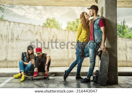Couples skate the parking garage - stock photo