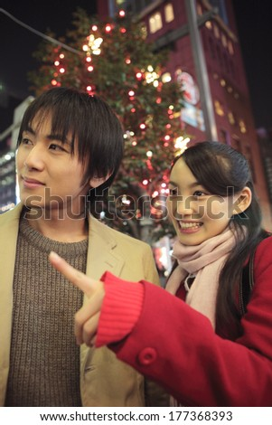 Couples walking on the streets on Christmas - stock photo
