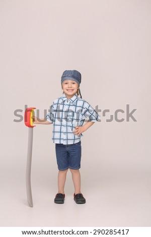 Courageous little boy in do-rag keeping sword. Boy in full length wearing do-rag.  - stock photo