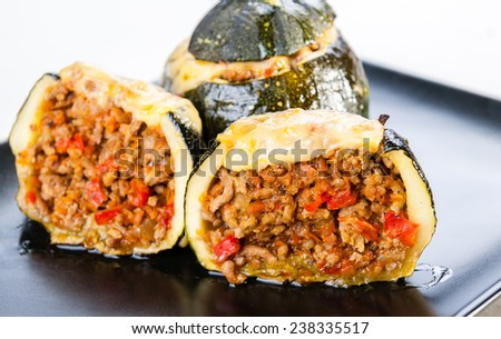 Courgettes stuffed with meat baked with cheese - stock photo