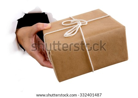 Courier delivering or giving parcel through torn white paper background, isolated - stock photo