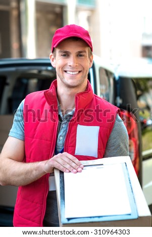 Courier Delivering Package By Van - stock photo