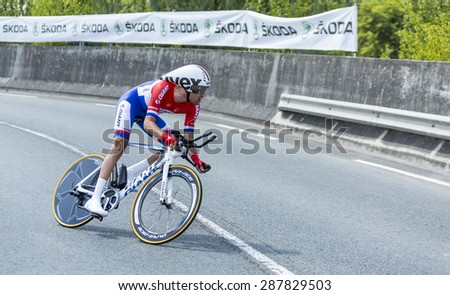 COURSAC,FRANCE-JUL 26:The Dutch cyclist Tom Dumoulin (Team Giant-Shimano) pedaling during the stage 20 ( time trial Bergerac - Perigueux) of Le Tour de France 2014.  - stock photo
