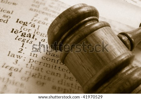 court gavel and legal definition, closeup from above - stock photo