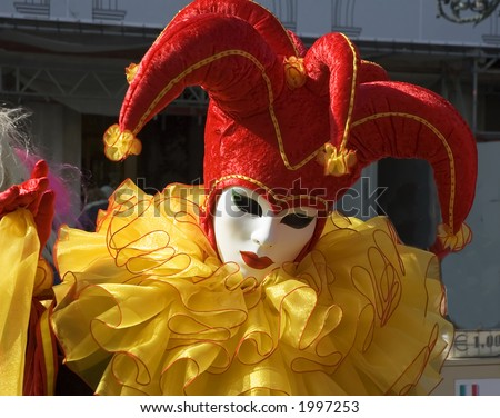 Court Jester dressed in red and yellow for the festival Carnival,in Venice,Italy,Saint Marks Square - stock photo