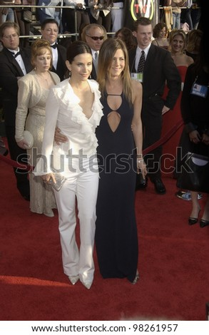COURTENEY COX (left) & JENNIFER ANISTON at the 9th Annual SCREEN ACTORS GUILD AWARDS in Los Angeles. March 9, 2003  Paul Smith / Featureflash - stock photo