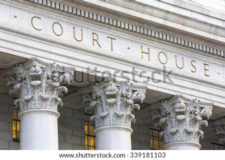 Courthouse facade with columns. - stock photo