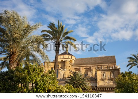 Courtyard garden and Mezquita Cathedral (The Great Mosque) historic architecture in Cordoba, Spain, Andalusia region. - stock photo