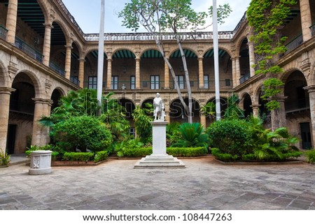 Courtyard of a spanish colonial palace in Havana with a statue of Christopher Columbus - stock photo