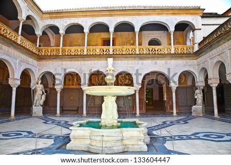 Courtyard of  La Casa De Pilatos In Seville, Spain. The building is a precious palace in mudejar spanish style. - stock photo