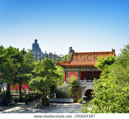 Courtyard of the Po Lin Monastery and the Tian Tan Buddha (the Big Buddha) in the background, at Lantau Island, in Hong Kong. Hong Kong is popular tourist destination of Asia. - stock photo