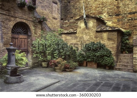 Courtyard with Water Fountain in Medieval Village of Buonconvento, Italy - stock photo