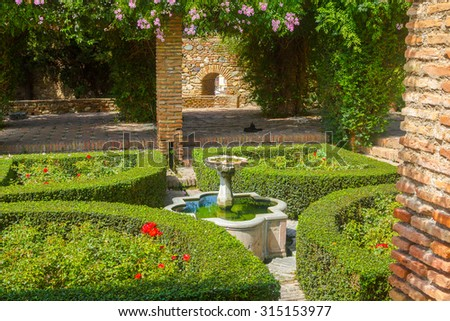 Courtyards and gardens of the famous Palace of the Alcazaba in Malaga Spain - stock photo