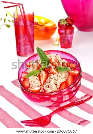 cous cous salad with strawberry - stock photo