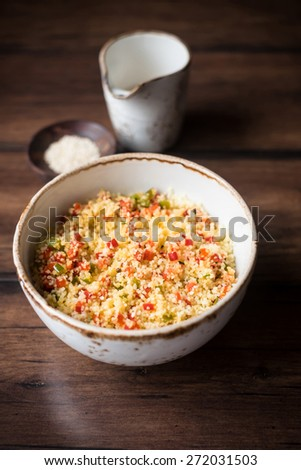 Couscous and roasted vegetables salad, selective focus - stock photo