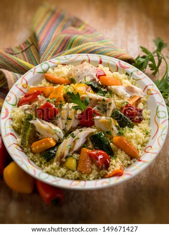 couscous with fish and vegetables, selective focus - stock photo