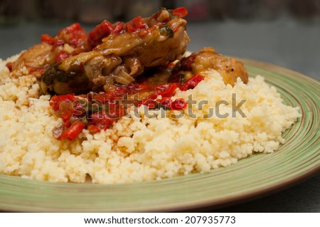 couscous with kitchen and pepper closeup - stock photo