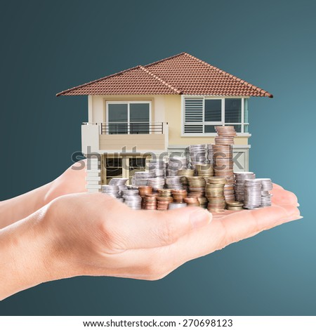 Cover model house with your deposit money.  - stock photo