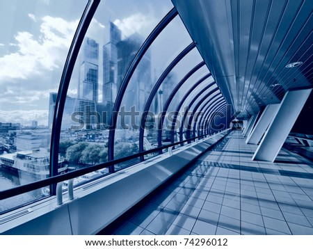 Covered bridge and skyscrapers beyond window. Moscow City - stock photo