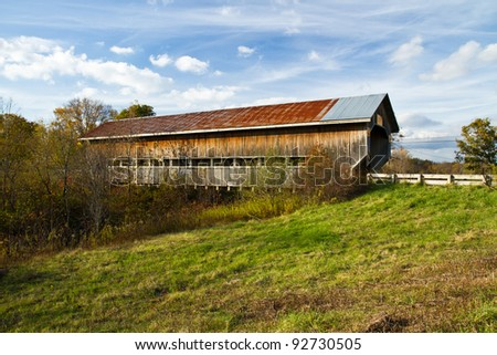 Covered bridge in Ashtabula County, Ohio on a fall day - stock photo