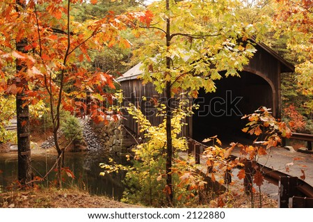 covered bridge in New England during the fall colors - stock photo