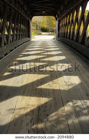 covered bridge in new england in autumn - stock photo