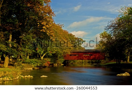 Covered bridge spanning the Yellow Breeches at Messiah College in Mechanicsburg, PA - stock photo