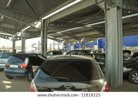 covered parking near to big supermarket - stock photo