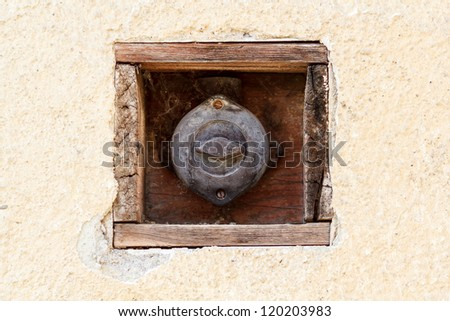 covered vintage retro light switch on house wall - stock photo