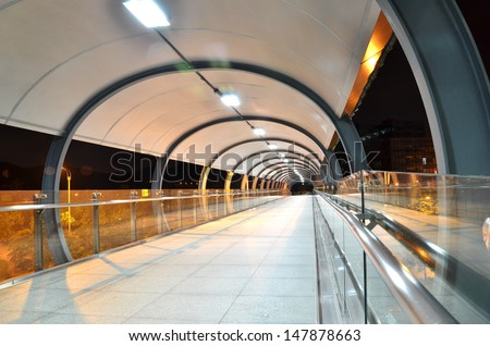 Covered walkway over railway tracs  - stock photo