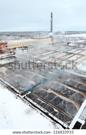 Covered with snow sewage treatment plant - stock photo