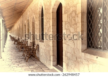 Covered Wooden Gallery in Jerusalem, Israel, Vintage Style Toned Picture - stock photo