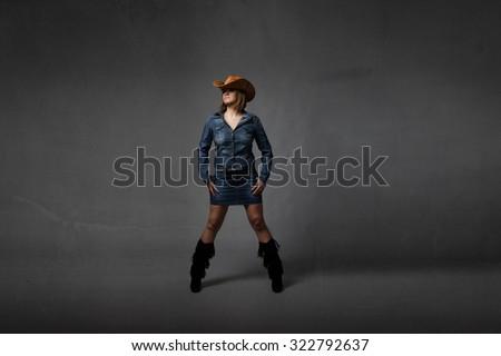 cow boy concept posing, abstract room - stock photo