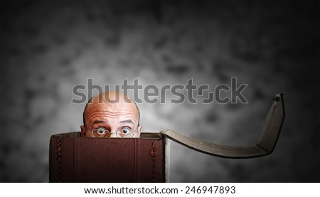 cowardly man in a box - stock photo
