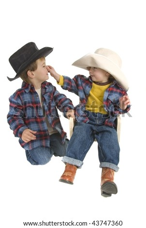 Cowboy brothers tease by pulling on nose - stock photo