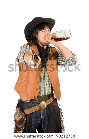 Cowboy drinking whiskey from the bottle. Isolated on white - stock photo