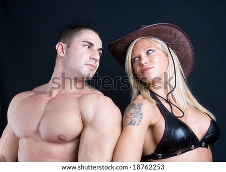 Cowboy girl and boy. Art shot of a pretty models . - stock photo