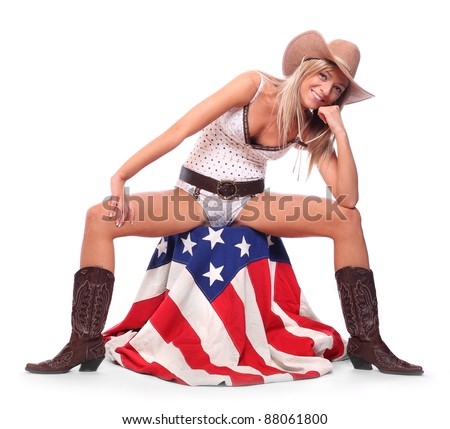 Cowboy girl sitting on a american flag. - stock photo