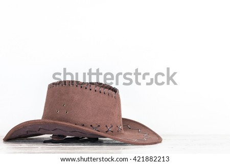 Cowboy hat on wooden table - stock photo