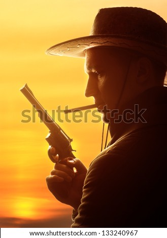 cowboy in hat with cigar and revolver silhouette - stock photo
