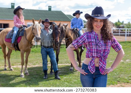 cowboy lady with husband and children - stock photo